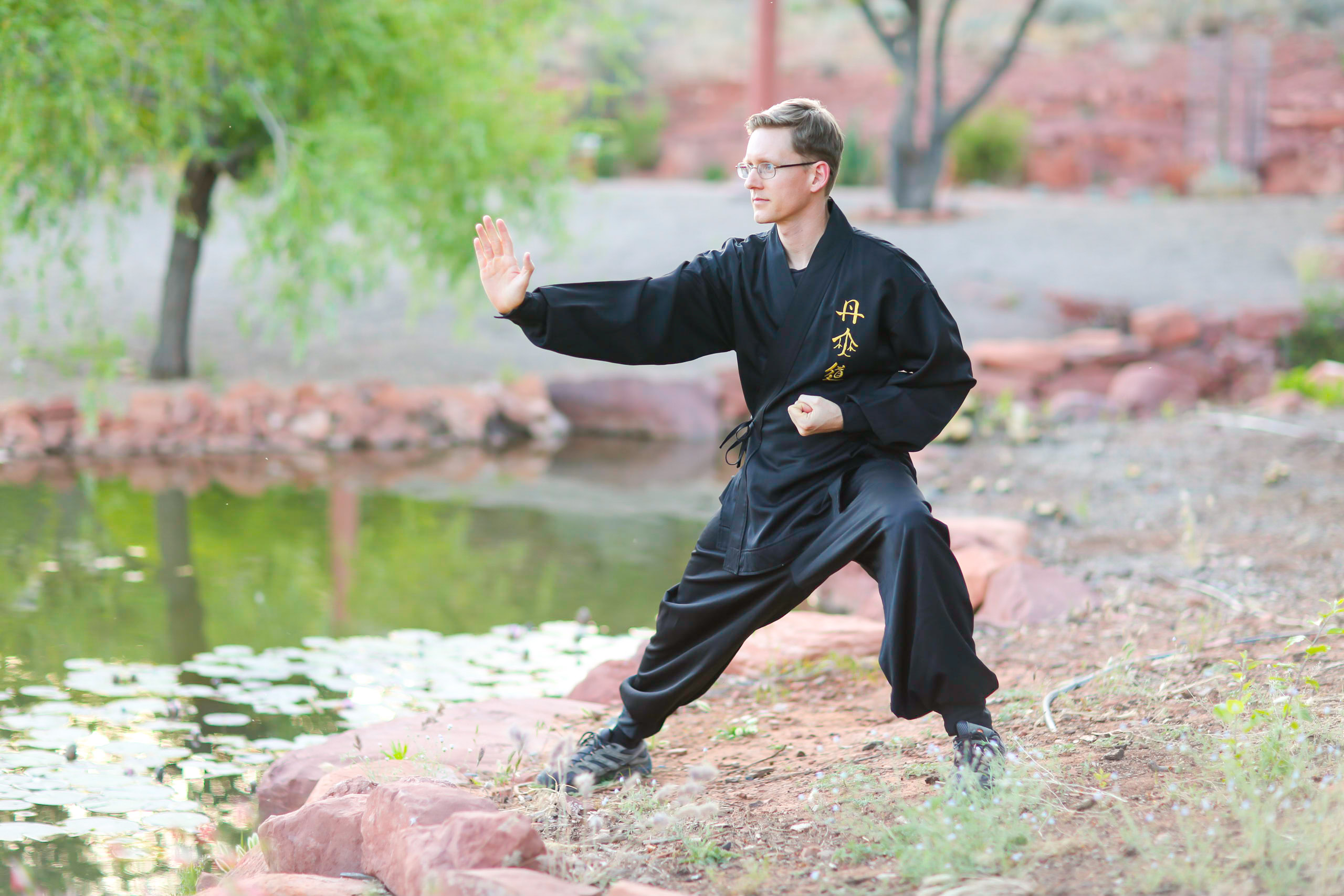 Instructor Travis guiding tai chi